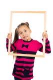 Κορίτσι και ένα πλαίσιο Στοκ Φωτογραφίες