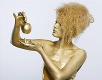 κορίτσι μήλων χρυσό Στοκ φωτογραφίες με δικαίωμα ελεύθερης χρήσης