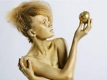 κορίτσι μήλων χρυσό Στοκ Φωτογραφία