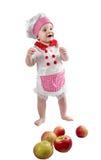 Κορίτσι μαγείρων μωρών που φορά το καπέλο αρχιμαγείρων με τα φρέσκα λαχανικά και τα φρούτα. Στοκ φωτογραφία με δικαίωμα ελεύθερης χρήσης
