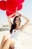 Κορίτσι με κόκκινα ballons Στοκ φωτογραφία με δικαίωμα ελεύθερης χρήσης