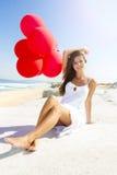 Κορίτσι με κόκκινα ballons Στοκ Φωτογραφία