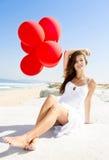 Κορίτσι με κόκκινα ballons Στοκ εικόνα με δικαίωμα ελεύθερης χρήσης