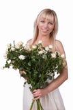 Κορίτσι με μια ανθοδέσμη των τριαντάφυλλων στοκ εικόνα