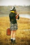 Κορίτσι με μια βαλίτσα Στοκ Εικόνες