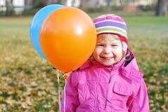Κορίτσι με τα μπαλόνια Στοκ Εικόνες