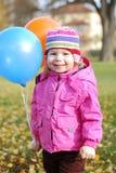 Κορίτσι με τα μπαλόνια Στοκ εικόνα με δικαίωμα ελεύθερης χρήσης