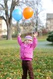 Κορίτσι με τα μπαλόνια Στοκ Εικόνα