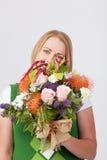Κορίτσι με τα λουλούδια Στοκ Εικόνα