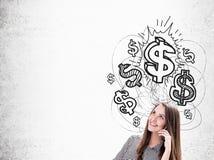 Κορίτσι με τα σημάδια κινητών τηλεφώνων και δολαρίων Στοκ εικόνα με δικαίωμα ελεύθερης χρήσης