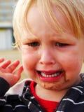 Κορίτσι με την άμμο στο πρόσωπο και το μάτι Στοκ φωτογραφία με δικαίωμα ελεύθερης χρήσης