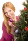 Κορίτσι με τη σφαίρα Χριστουγέννων Στοκ Εικόνες