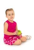 Κορίτσι με τη Apple στα χέρια Στοκ εικόνα με δικαίωμα ελεύθερης χρήσης