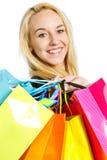 Κορίτσι με τις τσάντες αγορών Στοκ εικόνα με δικαίωμα ελεύθερης χρήσης