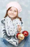 Κορίτσι με τους βολβούς Χριστουγέννων Στοκ φωτογραφία με δικαίωμα ελεύθερης χρήσης