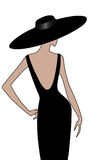 Κορίτσι με το καπέλο κατά τη μαύρη πίσω άποψη φορεμάτων Στοκ Φωτογραφία