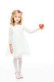 Κορίτσι με το κόκκινο σημάδι καρδιών Στοκ φωτογραφία με δικαίωμα ελεύθερης χρήσης