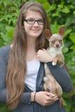 Κορίτσι με το σκυλί Στοκ Φωτογραφίες