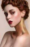 Κορίτσι με το χρυσό makeup στοκ φωτογραφία με δικαίωμα ελεύθερης χρήσης