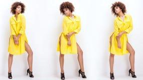 Κορίτσι με το afro στο κίτρινο φόρεμα Στοκ Φωτογραφίες