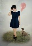 Κορίτσι, μπαλόνι και γάτα Στοκ Εικόνες