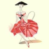 Κορίτσι μόδας στο κόκκινο φλυτζάνι ποτών φορεμάτων του τσαγιού Απεικόνιση αποθεμάτων