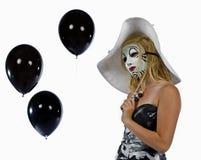 Κορίτσι πίσω από τη μάσκα Στοκ Εικόνες