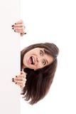 κορίτσι πινάκων διαφημίσεων που φαίνεται έκπληκτο λευκό στοκ εικόνες