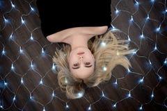 Κορίτσι που βρίσκεται στο πάτωμα Στοκ Εικόνα