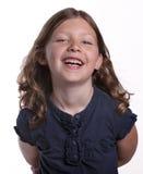 κορίτσι που γελά ελάχισ&tau Στοκ φωτογραφία με δικαίωμα ελεύθερης χρήσης