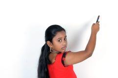 κορίτσι που εμφανίζει νε& Στοκ Φωτογραφίες