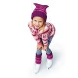 Κορίτσι που κάνει πατινάζ στο πατινάζ πάγου η ανασκόπηση απομόνωσε το λευκό Στοκ Φωτογραφία