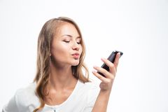 Κορίτσι που κάνει την τηλεοπτική κλήση με το smartphone Στοκ Φωτογραφίες