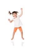 κορίτσι που πηδά ελάχιστα Στοκ Εικόνες