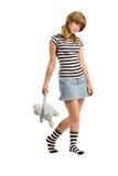 Κορίτσι που στέκεται με το μαλακό παιχνίδι Στοκ φωτογραφία με δικαίωμα ελεύθερης χρήσης