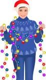 Κορίτσι που στέκεται στη γιρλάντα εκμετάλλευσης πουλόβερ απεικόνιση αποθεμάτων