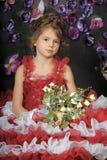 Κορίτσι σε ένα έξυπνο κόκκινο φόρεμα Στοκ εικόνα με δικαίωμα ελεύθερης χρήσης