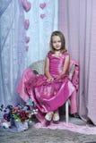 Κορίτσι σε ένα ρόδινο φόρεμα Στοκ Φωτογραφία