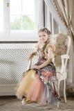 Κορίτσι στην έδρα Στοκ Φωτογραφίες