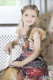 Κορίτσι στην έδρα Στοκ Φωτογραφία