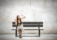 Κορίτσι στον πάγκο Στοκ Εικόνα