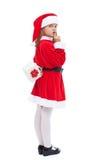 Κορίτσι στο κοστούμι santa που προετοιμάζει μια έκπληξη στοκ φωτογραφία με δικαίωμα ελεύθερης χρήσης
