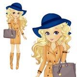 Κορίτσι στο μπλε καπέλο και την κλασική τσάντα απεικόνιση αποθεμάτων