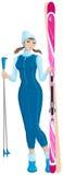 Κορίτσι στο μπλε που κρατά να κάνει σκι Στοκ φωτογραφία με δικαίωμα ελεύθερης χρήσης