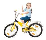 Κορίτσι στο ποδήλατο που απομονώνεται Στοκ Φωτογραφία