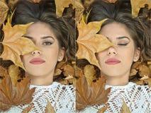 Κορίτσι της Νίκαιας που καλύπτεται με τα φθινοπωρινά φύλλα Νέα γυναίκα που καθορίζει στο έδαφος που καλύπτεται από το φύλλωμα πτώ Στοκ Εικόνες