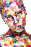 Κορίτσι το χρωματισμένο πρόσωπο που χρωματίζεται με Εικόνα ομορφιάς τέχνης Στοκ Εικόνες