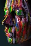 Κορίτσι το χρωματισμένο πρόσωπο που χρωματίζεται με Εικόνα ομορφιάς τέχνης Στοκ εικόνες με δικαίωμα ελεύθερης χρήσης