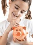 κορίτσι τραπεζών λίγα piggy Στοκ φωτογραφίες με δικαίωμα ελεύθερης χρήσης