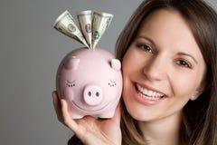 κορίτσι τραπεζών piggy στοκ εικόνες